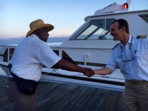 captain shakes hand