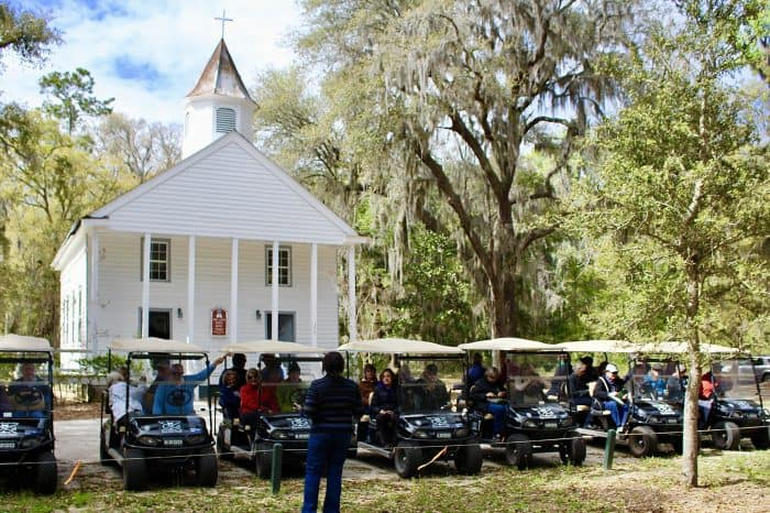 Golf carts lined up for a Daufuskie Island Gullah tour